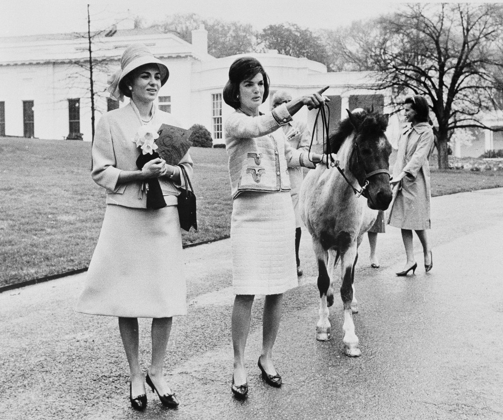 FILE - In this April 12, 1962, file photo first lady Jacqueline Kennedy gives a guided tour of the White House grounds to Empress Farah Pahlavi of Ira...