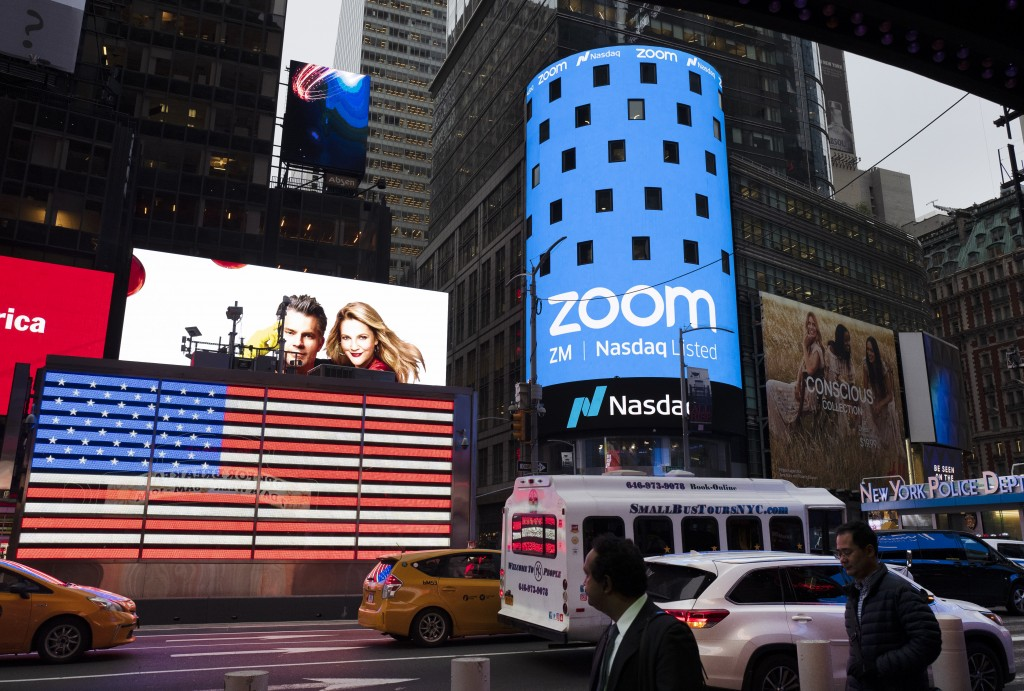 File-This April 18, 2019, file photo shows a Zoom ad, in New York. Zoom's videoconferencing service remains a fixture in pandemic life, but its breakn...