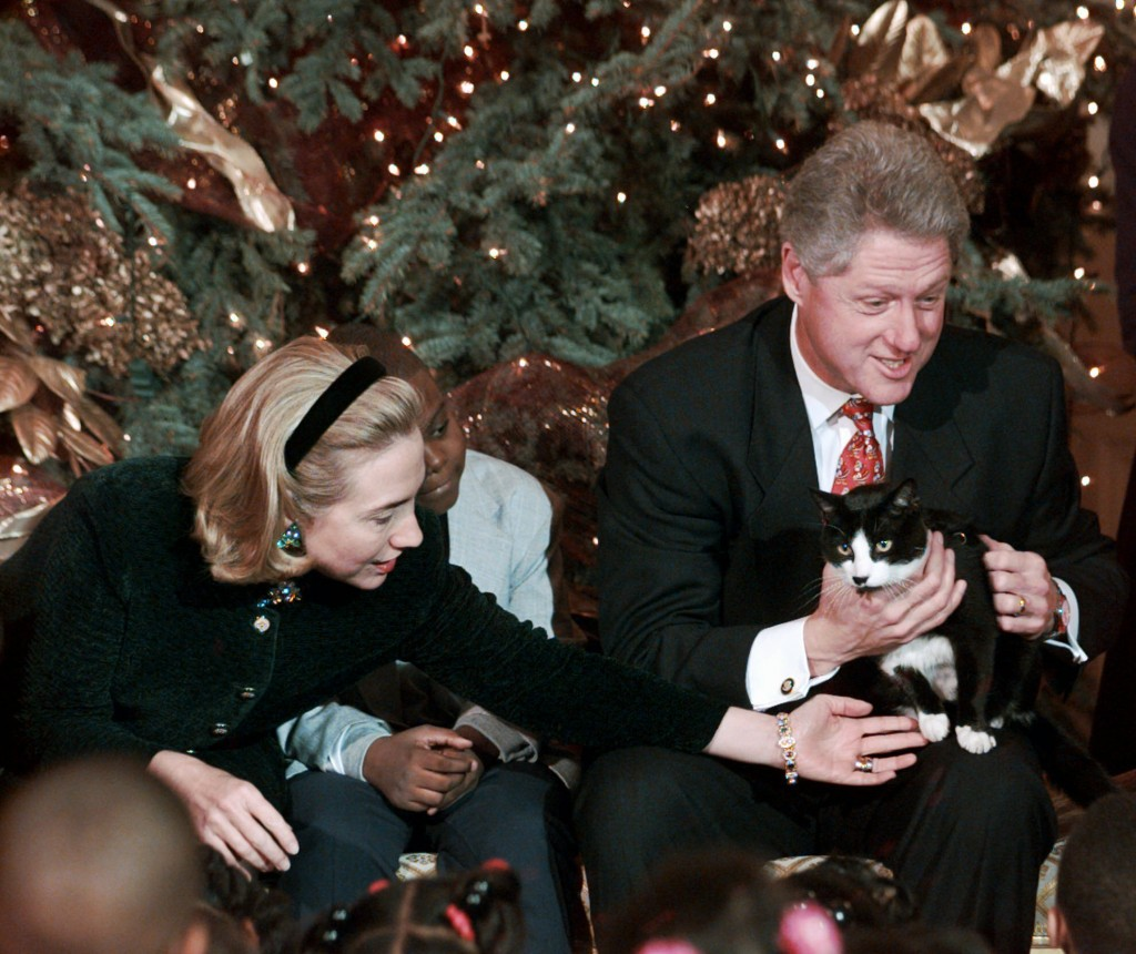FILE - In this Dec. 20, 1996, file photo President Clinton holds Socks the cat as he and first lady Hillary Clinton host Washington area elementary sc...