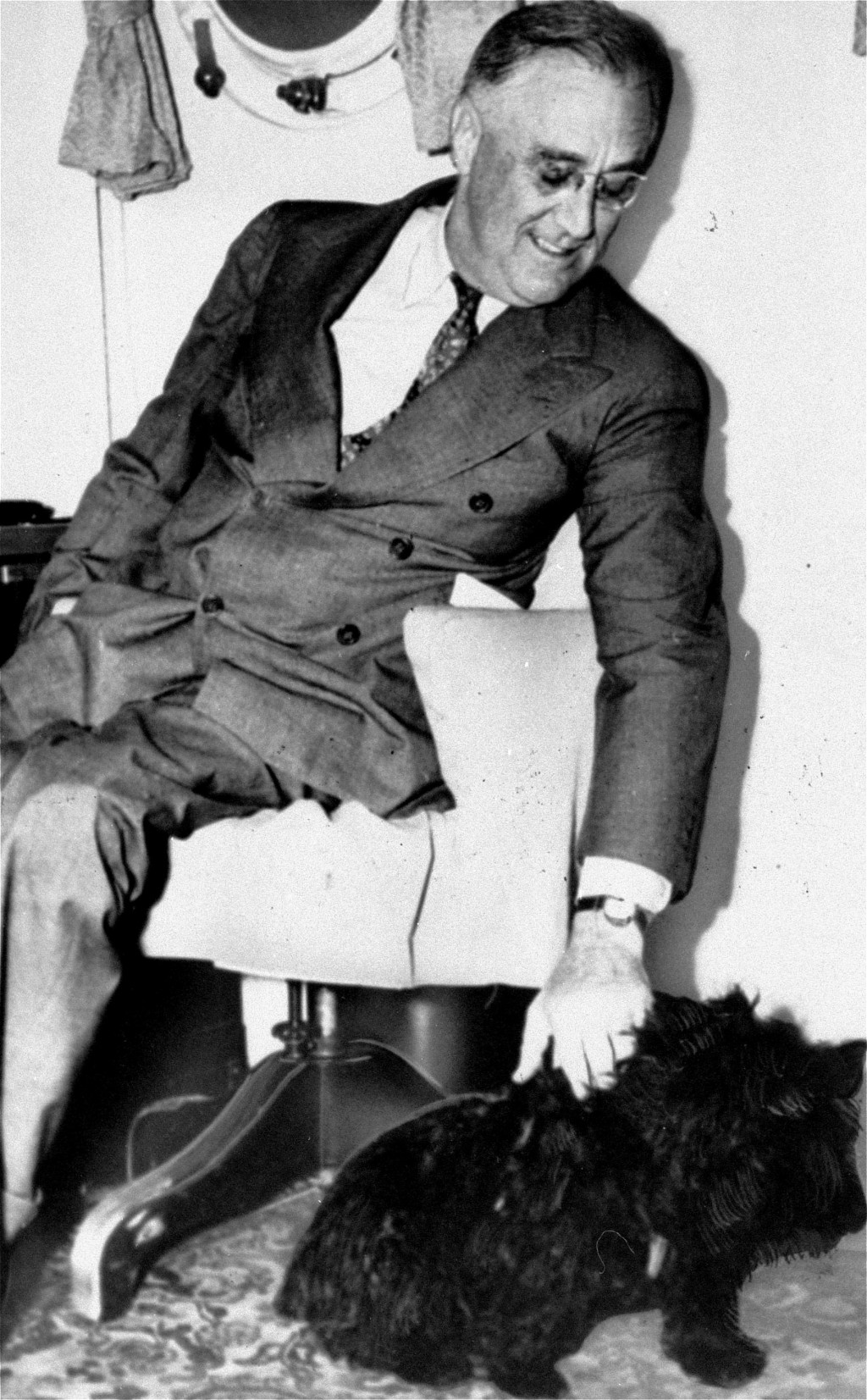 FILE - In this 1939, file photo President Franklin D. Roosevelt pets Fala, his Scottish terrier in Washington. The arrival of the Biden pets will also...