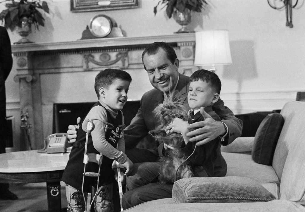 FILE - In this Feb. 5, 1969, file photo President Richard Nixon smiles as he shows off one of the White House pets tiny Yorkshire terrier Pasha to two...