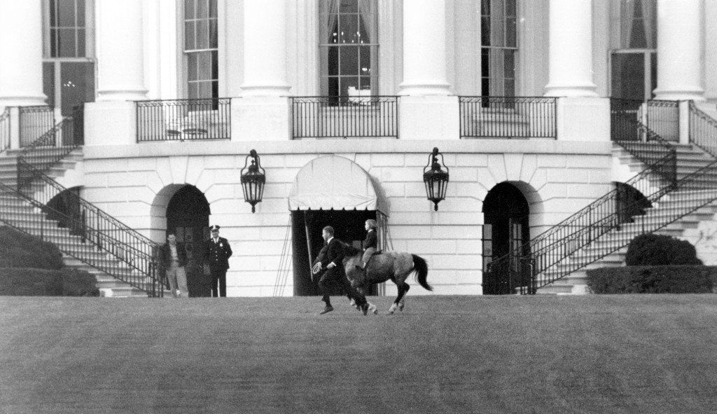 FILE - In this March 20, 1962 file photo, President John F. Kennedy's daughter Caroline Kennedy rides her pony, Macaroni, on the south grounds of the ...
