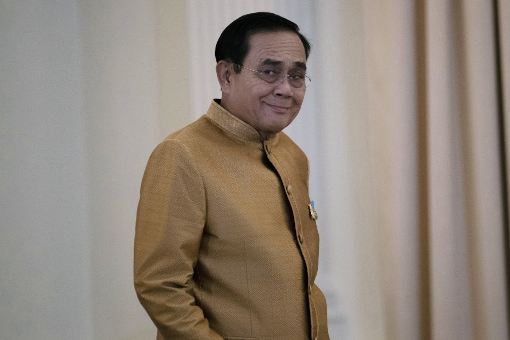 Thailand's Prime Minister Prayuth Chan-ocha arrives to speak to the media during a press conference at Government House in Bangkok, Thailand, Tuesday,...