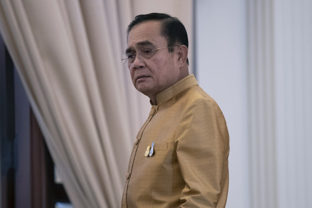 Thailand's Prime Minister Prayuth Chan-ocha leaves after a press conference at Government House in Bangkok, Thailand, Tuesday, Dec. 1, 2020. Thailand'...