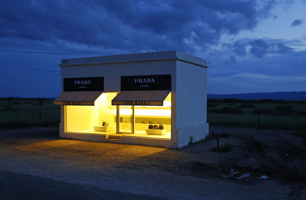 FILE - In this Sept. 6, 2016 file photo, dusk settles in over Prada Marfa, an art installation in Valentine, Texas. Marfa, a remote but trendy high de...