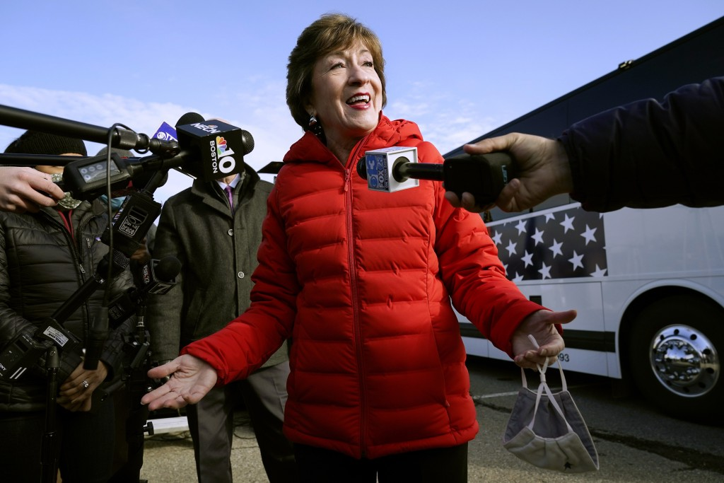 FILE - In this Nov. 4, 2020, file photo Republican Sen. Susan Collins, R-Maine, speaks to reporters in Bangor, Maine.A bipartisan group of lawmakers, ...
