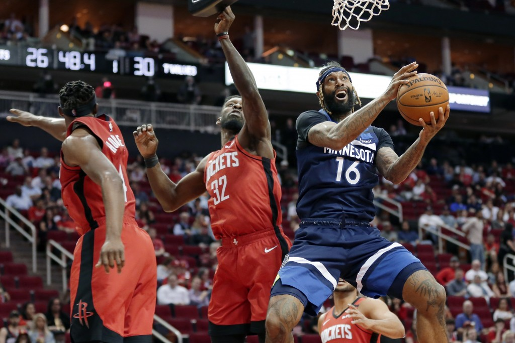 FILE - In this March 10, 2020, file photo, Minnesota Timberwolves forward James Johnson (16) shoots after getting past Houston Rockets forwards Danuel...