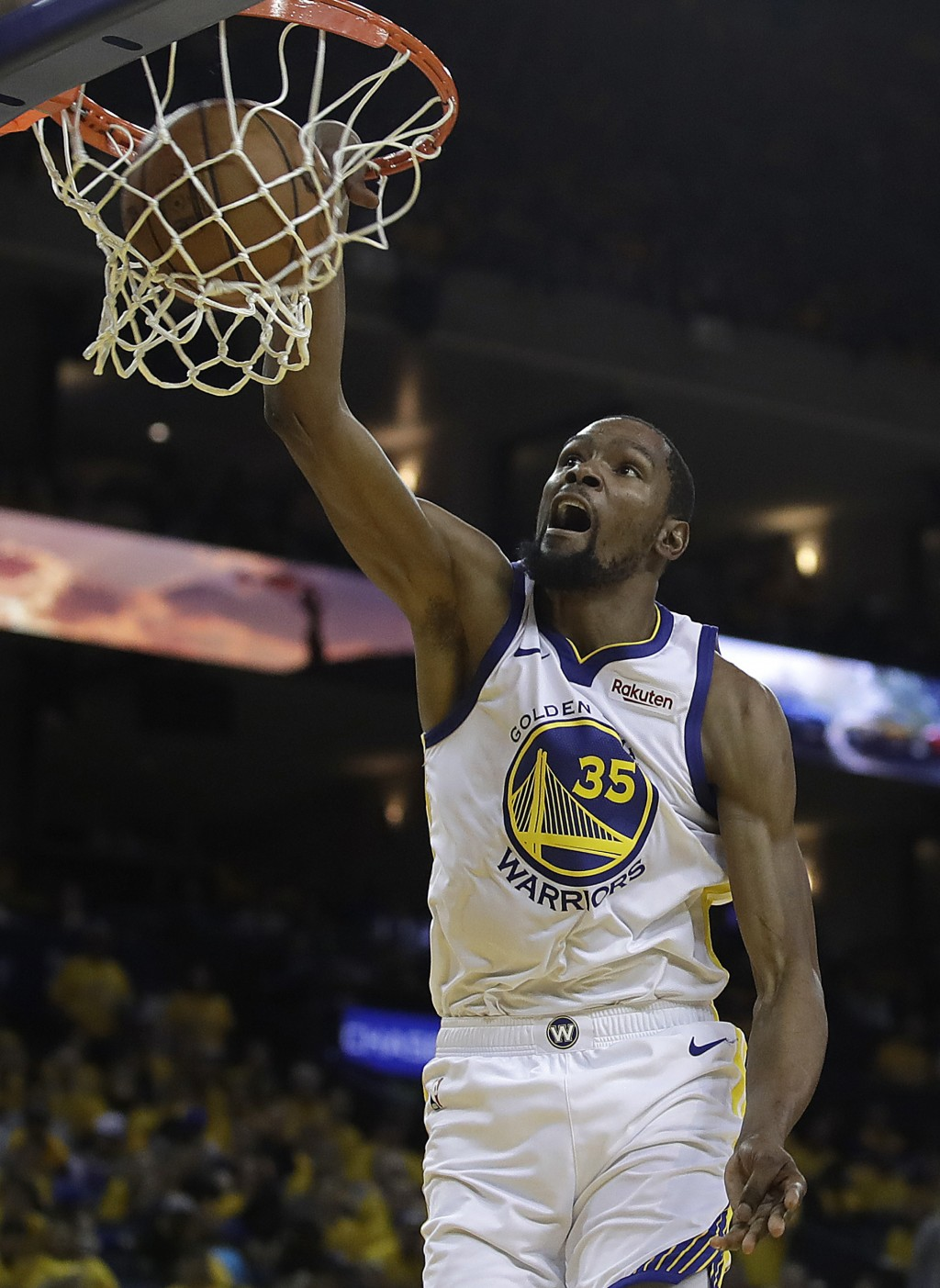 FILE - In this April 13, 2019, file photo, then-Golden State Warriors' Kevin Durant scores against the Los Angeles Clippers in the second half in Game...