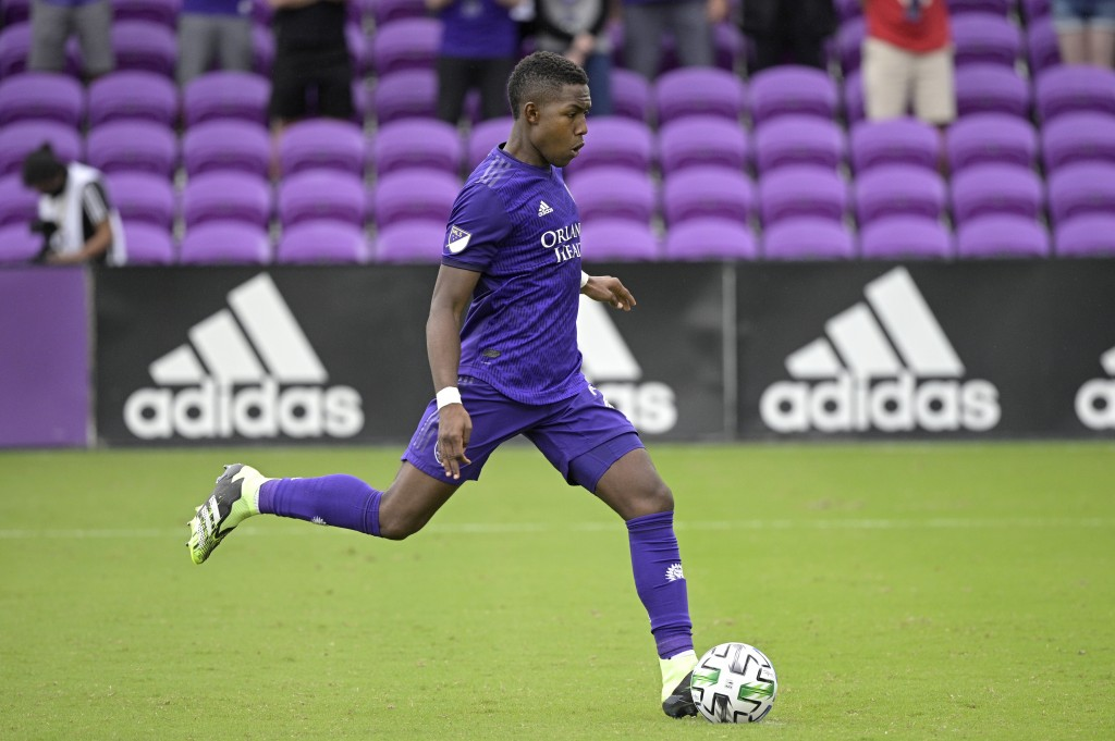 FILE - In this Nov. 21, 2020, file photo, Orlando City midfielder Andrés Perea makes a penalty kick during overtime of an MLS soccer playoff match aga...