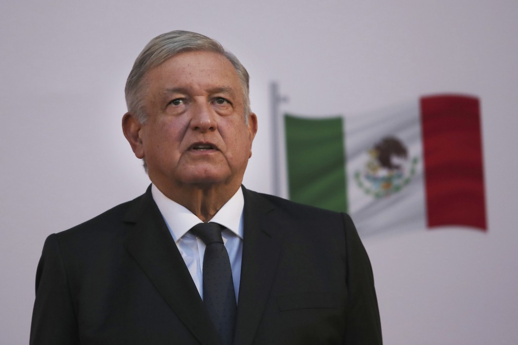 Mexican President Andrés Manuel López Obrador stands during the commemoration of his second anniversary in office, at the National Palace in Mexico Ci...