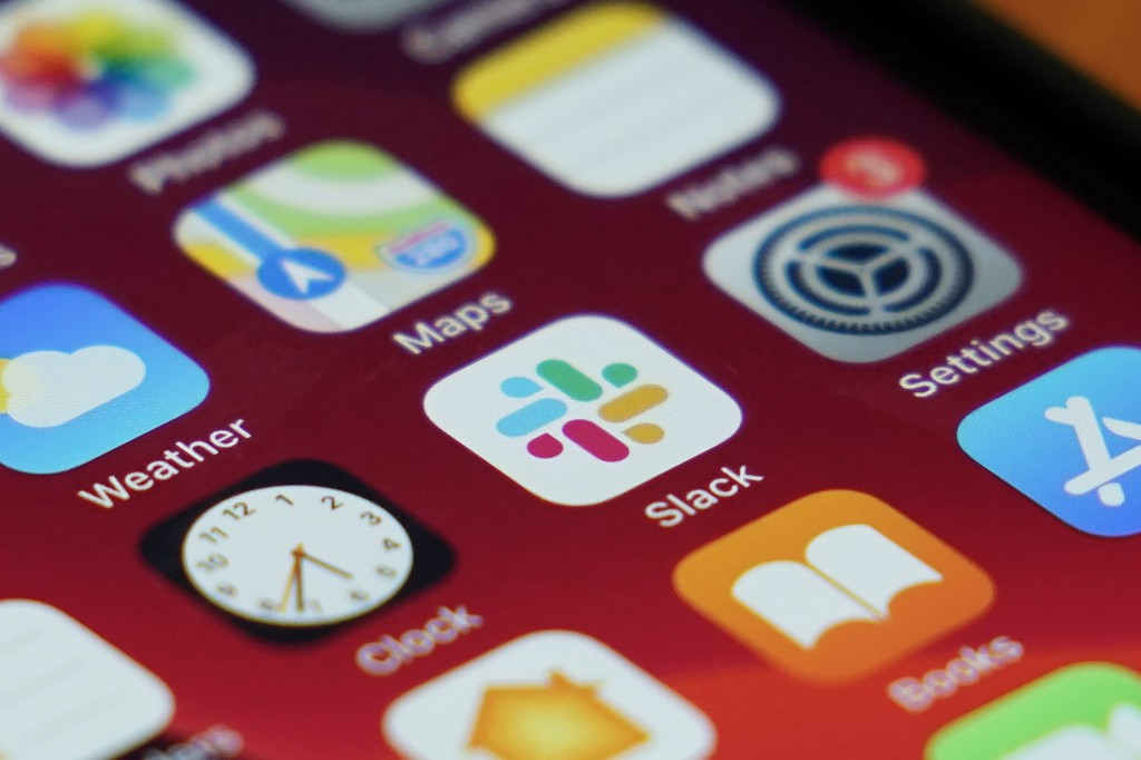 The Slack app icon is displayed on an iPhone screen, Tuesday, Dec. 1, 2020, in Long Beach, Calif. In a deal announced Tuesday, business software pione...