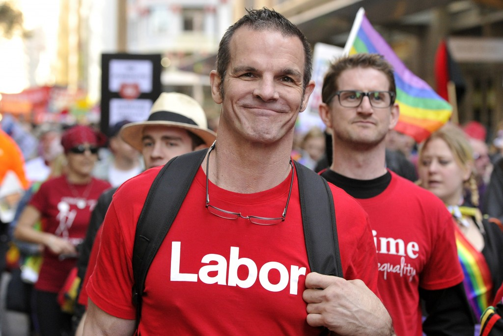 Labor Party candidate for Sydney City Council and former National Rugby League football player Ian Roberts marches in a marriage equality rally in Syd...