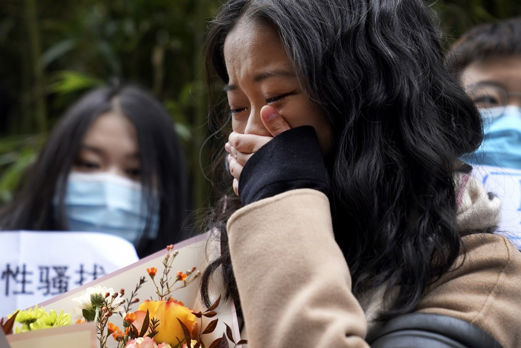 Zhou Xiaoxuan weeps as she speaks to her supporters upon arrival at a courthouse in Beijing, Wednesday, Dec. 2, 2020.