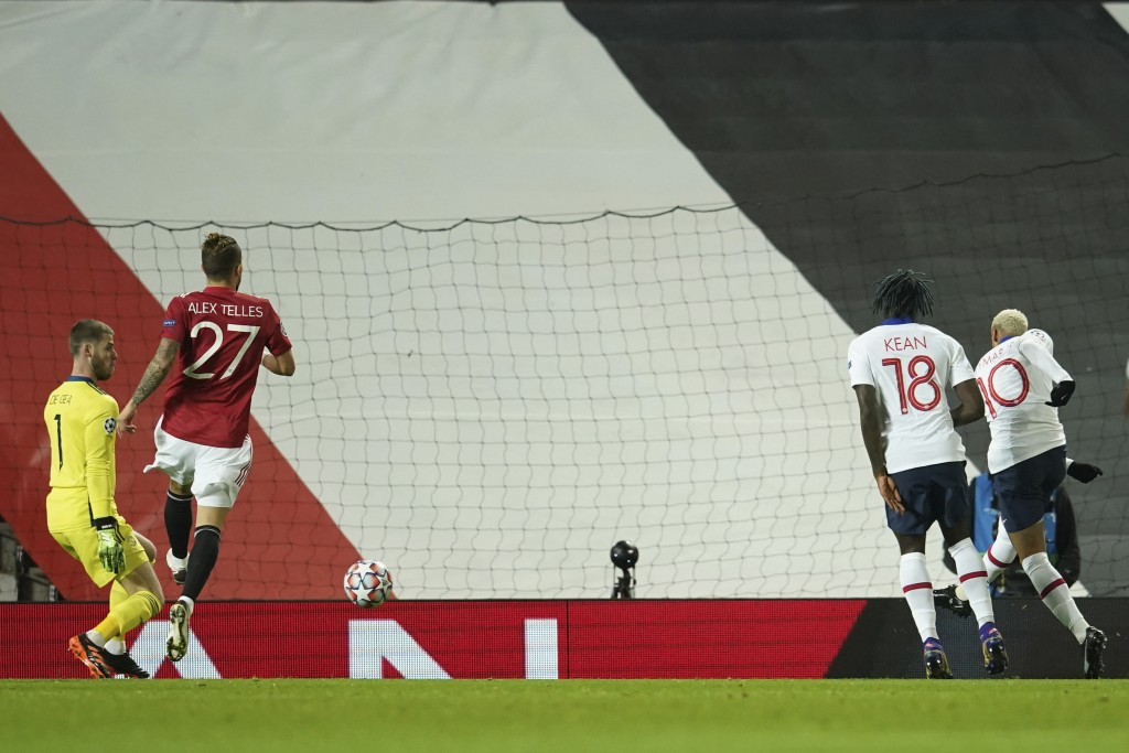 PSG's Neymar, right, shoots to score the opening goal during a Group H Champions League soccer match between Manchester United and Paris Saint Germain...