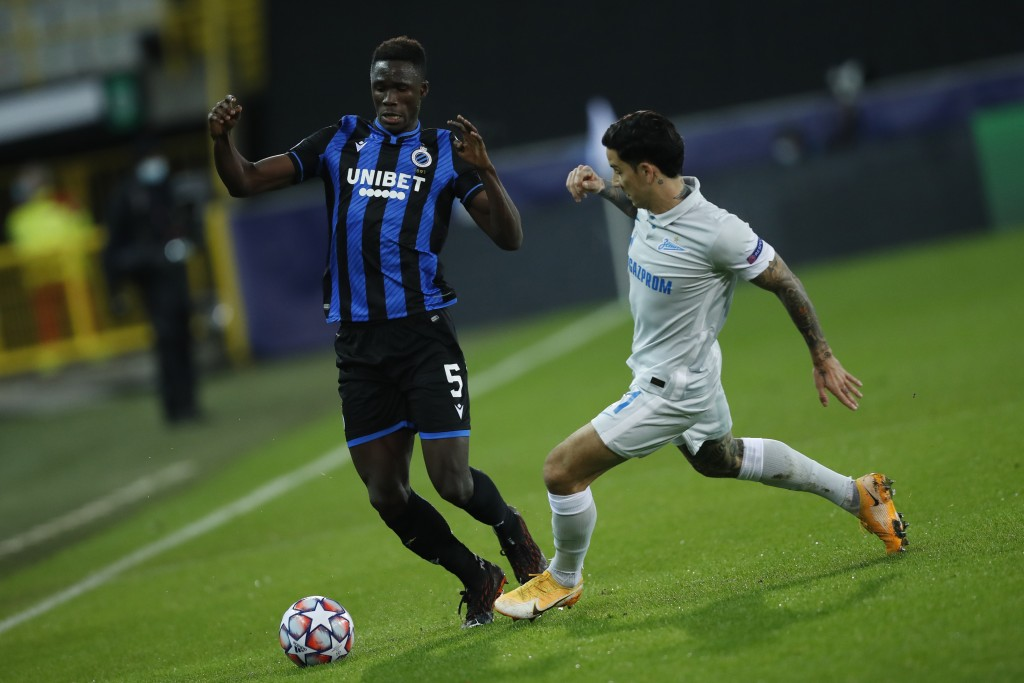 Brugge's Odilon Kossounou, left, vies for the ball with Zenit's Sebastian Driussi during a Champions league Group F soccer match between Brugge and Ze...