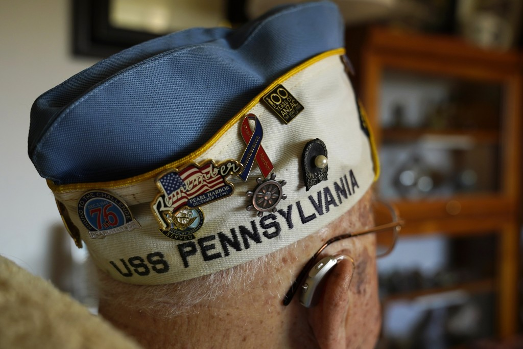 A number of commemorative pins adorn the hat of Mickey Ganitch, who served on the USS Pennsylvania during the 1941 attack on Pearl Harbor, at his home...