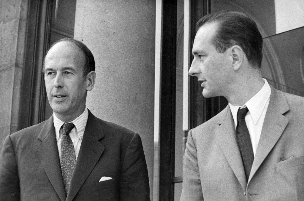 FILE - In this Aug.9 1969, Valery Giscard d'Estaing, left, as Finance Minister and Jacques Chirac as Secretary of State to Finance leave Elysee Palace...