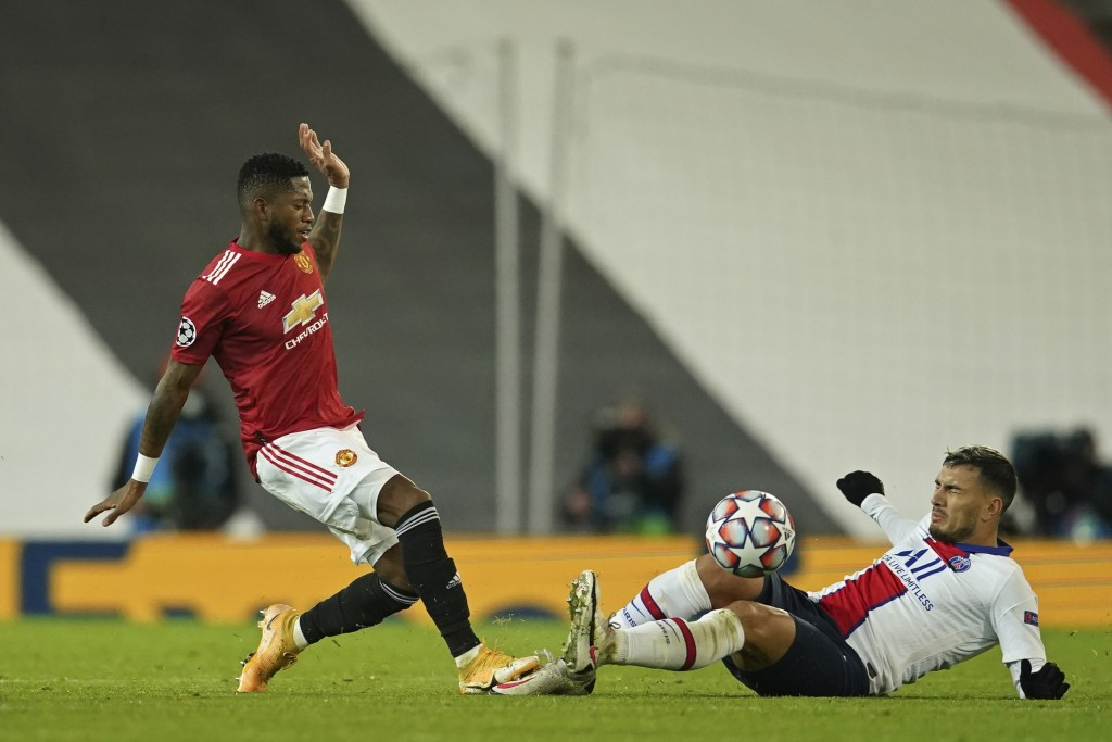 Manchester United's Fred, left, challenges for the ball with PSG's Leandro Paredes during a Group H Champions League soccer match between Manchester U...