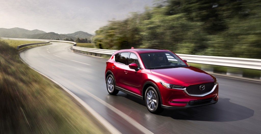 This photo provided by Mazda shows the 2021 Mazda CX-5.  Though a little smaller on the inside than its primary competition, the CX-5 makes up for tha...