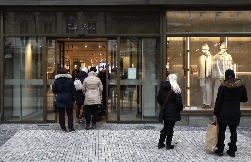 People enter a store in Prague, Czech Republic, Thursday, Dec. 3, 2020. A sign of normalcy has returned to the Czech Republic ahead of the Christmas p...