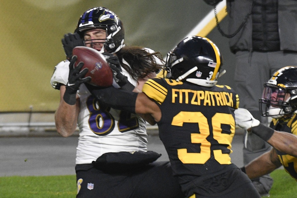 Pittsburgh Steelers free safety Minkah Fitzpatrick (39) breaks up a pass in the end zone to Baltimore Ravens tight end Luke Willson (82) as time runs ...
