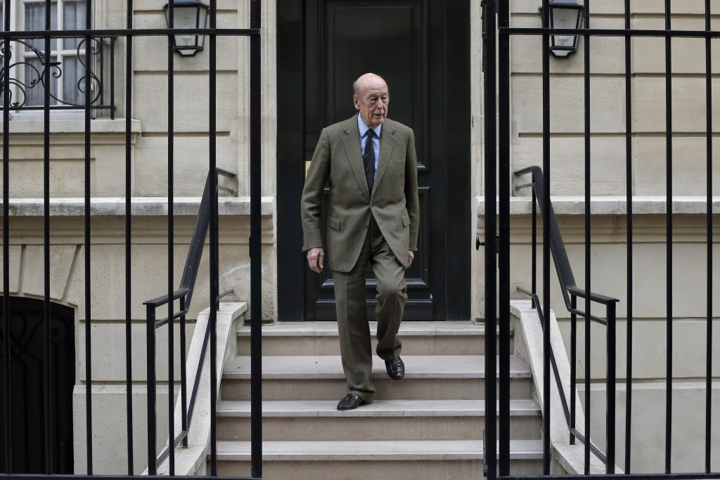 In this April 8, 2013 file photo, French former President Valery Giscard d'Estaing leaves his home in Paris. Valery Giscard d'Estaing, the president o...
