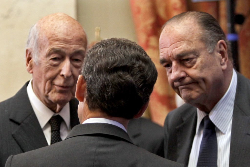 FILE - In this March 1, 2010 file photo, France's President Nicolas Sarkozy, center, speaks with former French Presidents, Jacques Chirac, right, and ...
