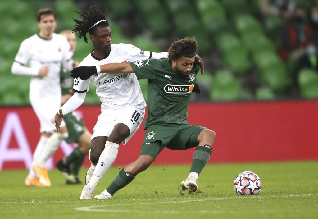 Rennes' Eduardo Camavinga, left, and Krasnodar's Tonny Vilhena challenge for the ball during the UEFA Champions League, Group E, soccer match between ...