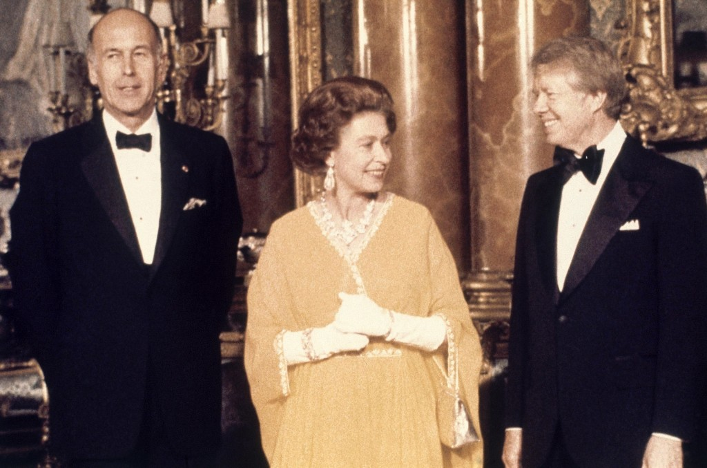FILE - In this file photo dated May 1977, U.S. President Jimmy Carter, right, and Britain's Queen Elizabeth II are photographed with French President ...