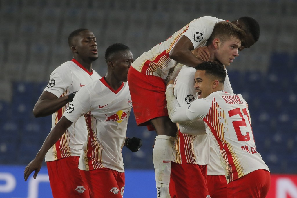 Leipzig's Alexander Sorloth, second right, celebrates with teammates his side's fourth goal during the Champions League group H soccer match between I...