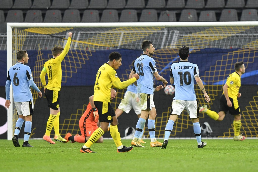 Dortmund's Raphael Guerreiro, right, celebrates after scoring his side's opening goal during the Champions League, Group F, soccer match between Borus...