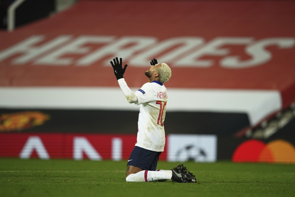 PSG's Neymar celebrates after scoring his side's third goal during a Group H Champions League soccer match between Manchester United and Paris Saint G...