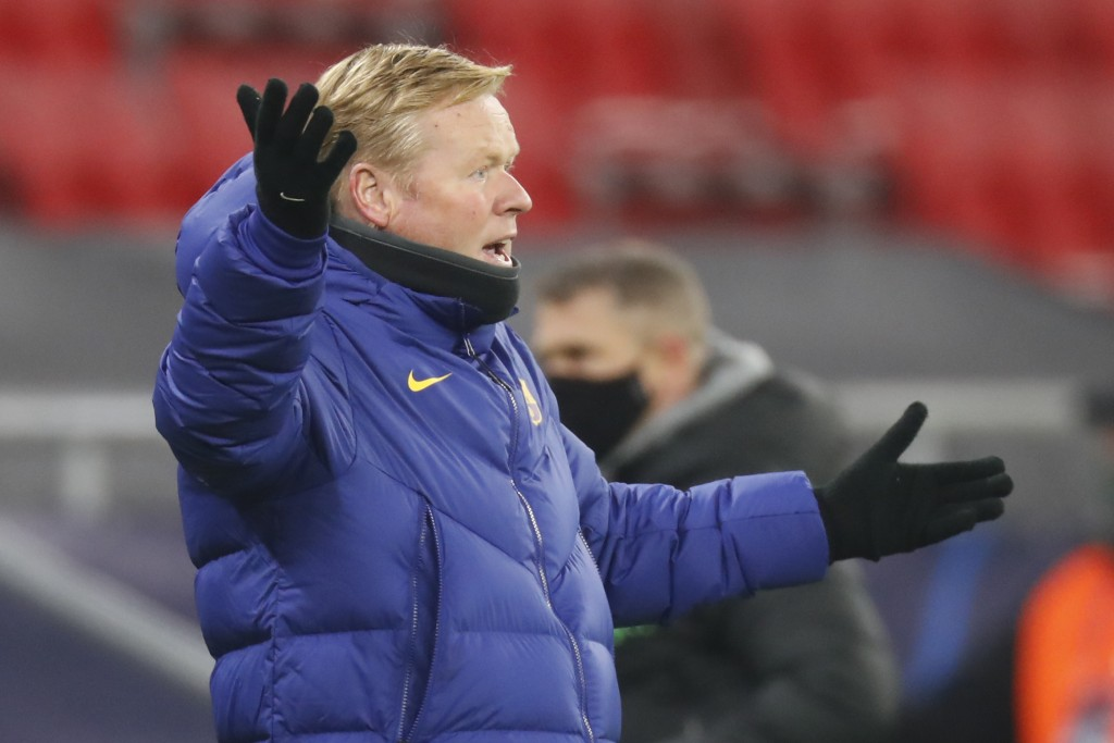 Barcelona's head coach Ronald Koeman reacts during the Champions League group G soccer match between Ferencvaros and Barcelona at the Ferenc Puskas st...