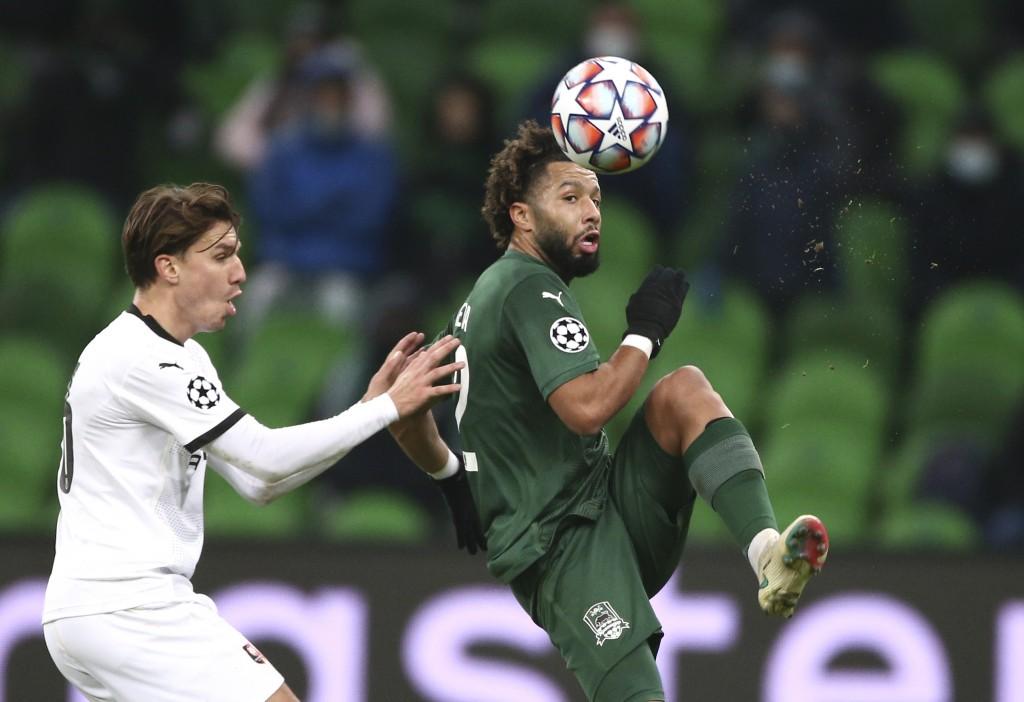 Krasnodar's Tonny Vilhena, right, controls the ball ahead of Rennes' Adrien Hunou during the UEFA Champions League, Group E, soccer match between Kras...