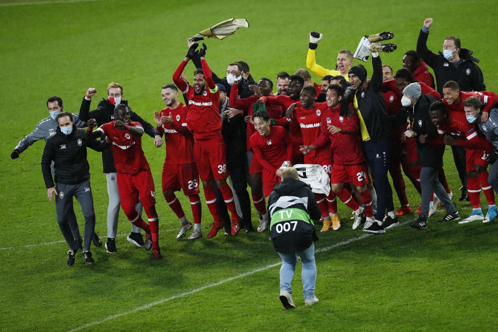 Royal Antwerp players celebrate at the end of the Europa League Group J soccer match between Antwerp and Ludogorets at the Bosuil stadium in Antwerp, ...