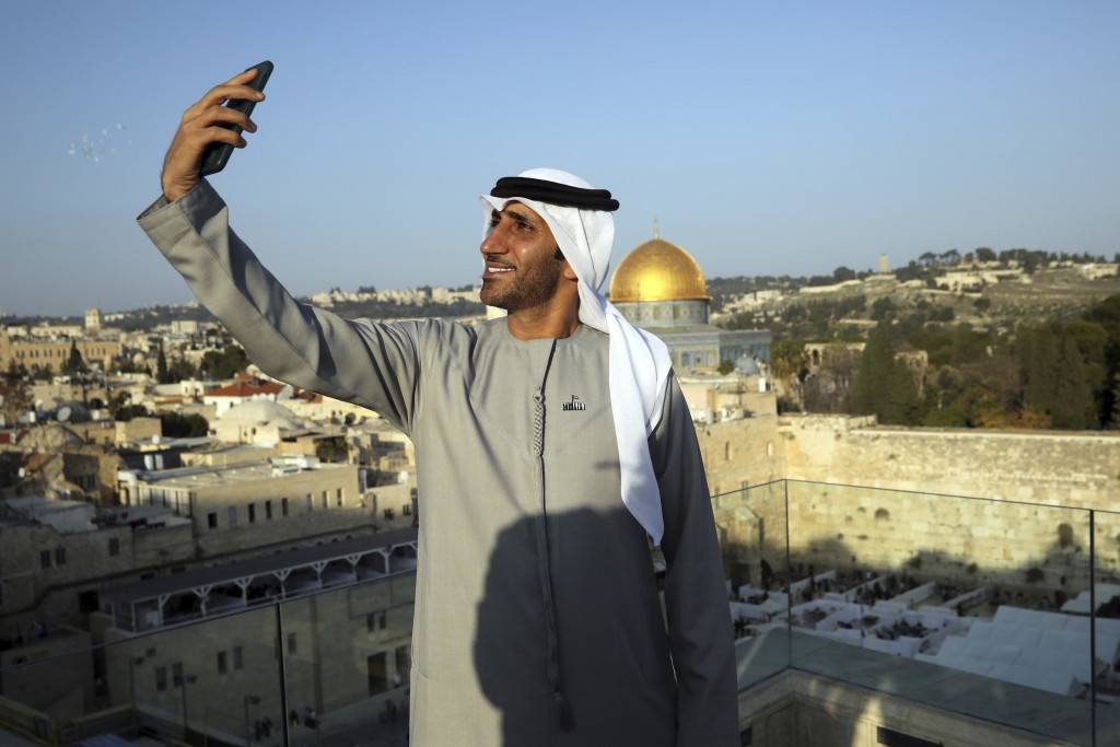Emirati singer Walid Aljasim, uses his phone overlooking the Dome of the Rock mosque during his visit in Jerusalem, Thursday, Dec. 3, 2020. (AP Photo/...