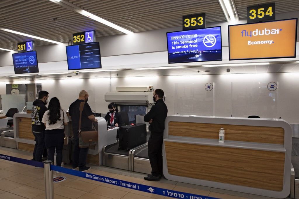 Israelis prepare to fly to Dubai at the Ben Gurion airport near Tel Aviv, Israel, Thursday, Dec. 3, 2020.   The Israeli government is urging its citiz...