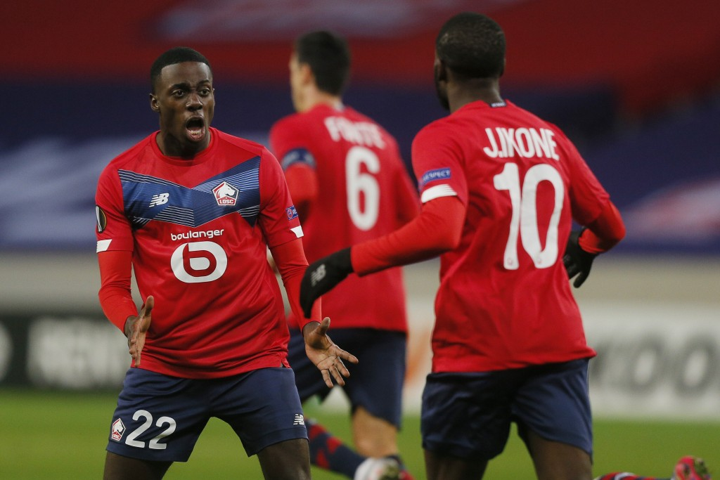 Lille's Timothy Weah, left and Lille's Jonathan Ikone celebrate after their teammate Lille's Burak Yilmaz scored his side's first goal during their Eu...