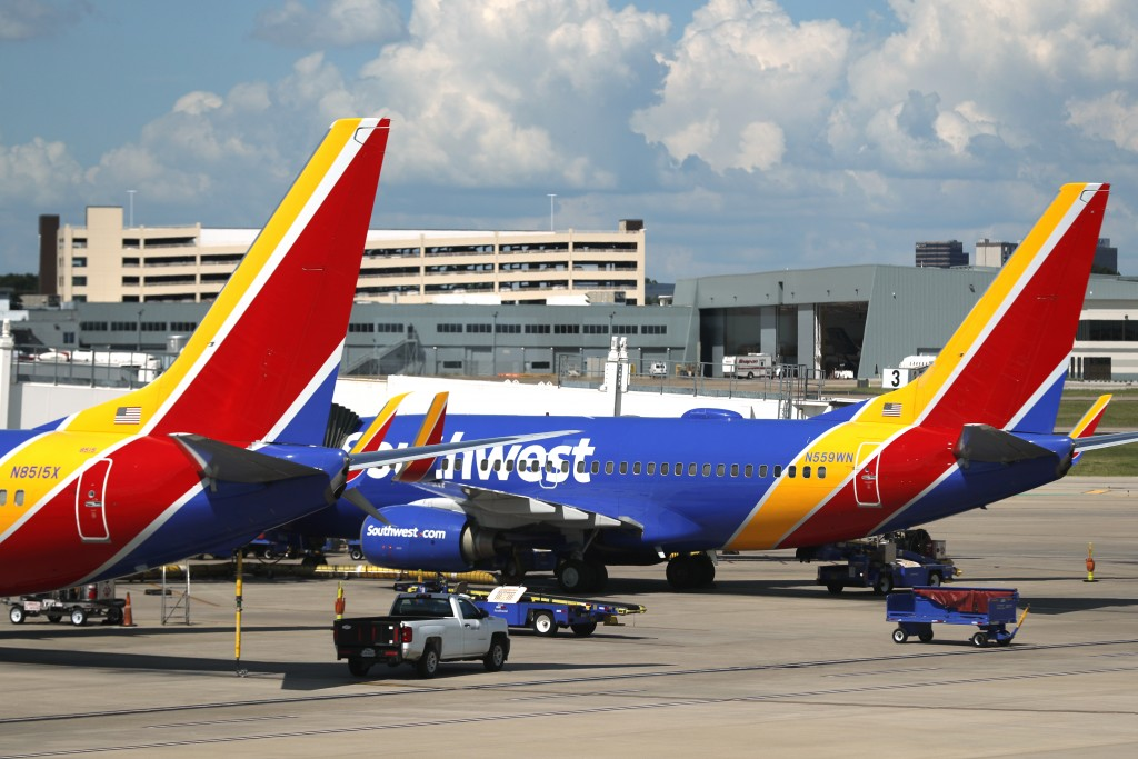 FILE - In this Wednesday, June 24, 2020, file photo, Southwest Airlines jets sit at gates at Love Field in Dallas. On Thursday, Dec. 3, 2020, the airl...