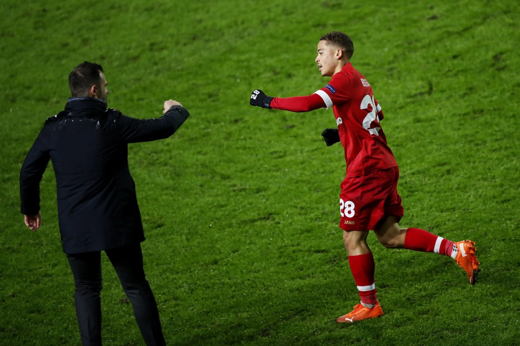 Royal Antwerp's Manuel Benson, right, celebrates with his manager Ivan Leko after scoring his side's third goal during the Europa League Group J socce...