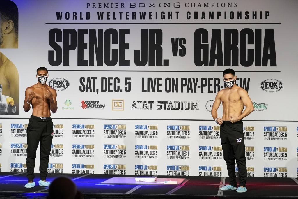 Boxers Errol Spence Jr., left, and Danny Garcia, right, pose after weigh-ins for their title match in Dallas, Friday, Dec. 4, 2020. Spence Jr. is putt...