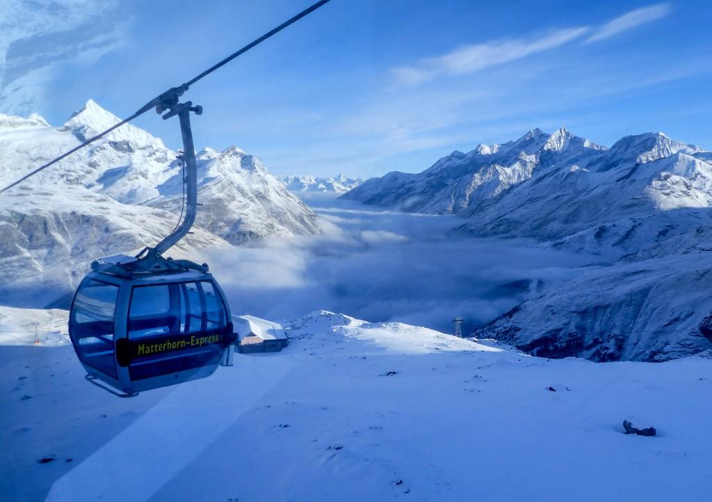An empty gondola goes up in Zermatt, Switzerland, Thursday, Dec.3, 2020. Zermatt is home to one of the Swiss ski stations that has become an epicenter...