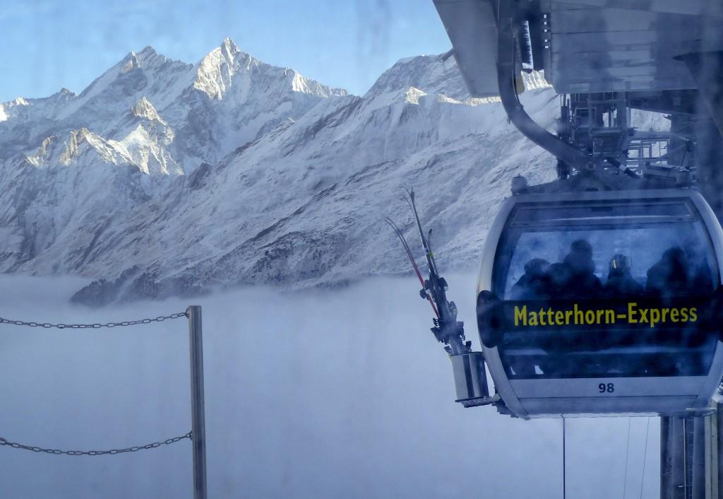 A gondola goes up next to the mountains around Zermatt, Switzerland, Thursday, Dec.3, 2020. Zermatt is home to one of the Swiss ski stations that has ...