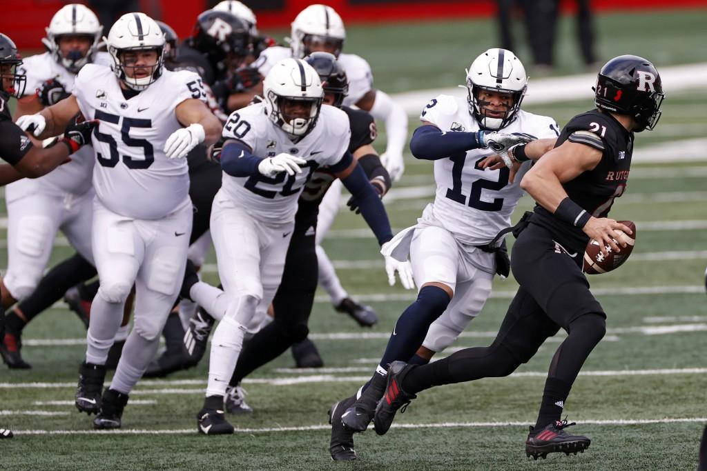 Penn State linebacker Brandon Smith (12) tackles Rutgers quarterback Johnny Langan (21) during the first half of an NCAA college football game Saturda...