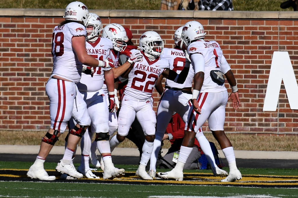 Arkansas running back Trelon Smith (22) is congratulated by teammates after scoring during the first half of an NCAA college football game against Mis...