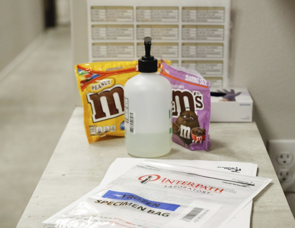 An unused test specimen bag sits at an employee station at Primary Health Medical Group's clinic in Boise, Idaho, Tuesday, Nov. 24, 2020. Troops direc...