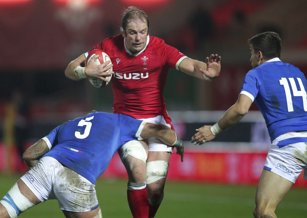 Wales' Alun Wyn Jones, right, is tackled by Italy's Niccolo Cannone, during the Autumn Nations Cup rugby match between Wales and Italy at Parc y Scarl...