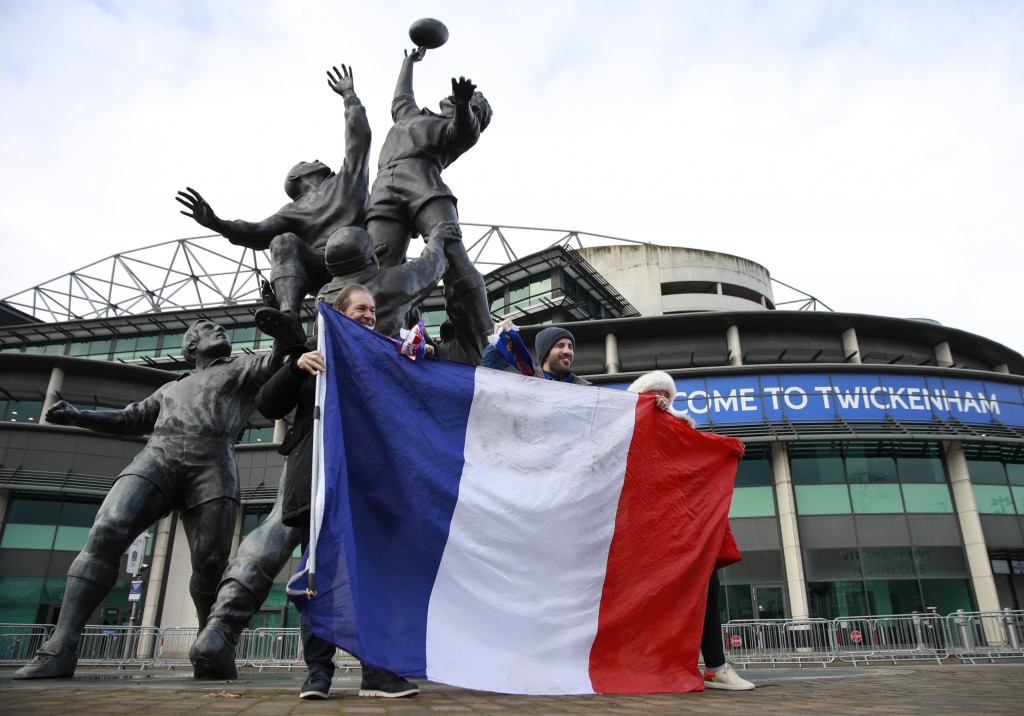 French supporters pose for a photo as they arrive for the Autumn Nations Cup final rugby union international match between England and France at Twick...