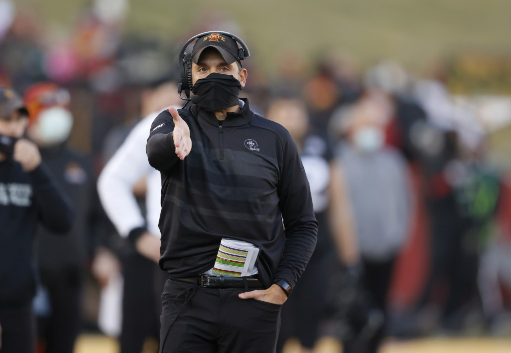 Iowa State head coach Matt Campbell gestures to an official after a call along the sideline during the first half of an NCAA college football game aga...