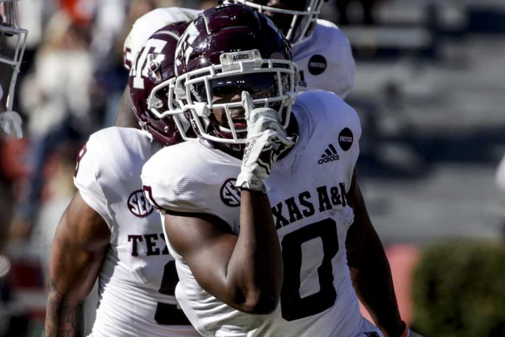 Texas A&M running back Ainias Smith (0) reacts after scoring a touchdown against Auburn during the second half of an NCAA college football game on Sat...